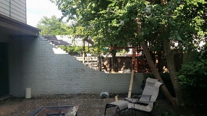 demolition brick wall patio.jpg